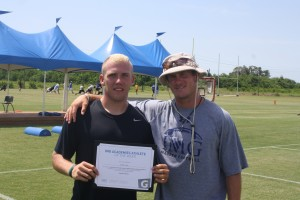 Garrett with Coach Adam Behrends