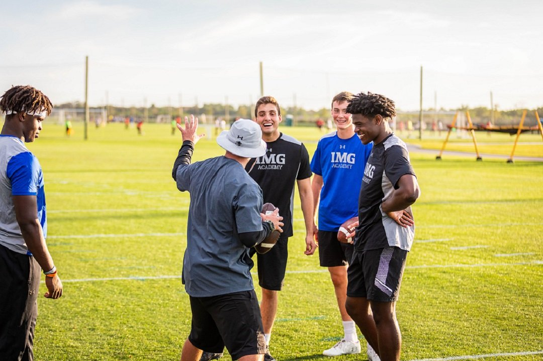 IMG Academy Football Campers Getting Coach Instruction | IMGAcademy.com