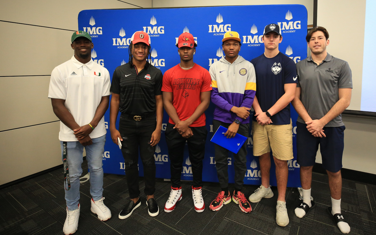 img football players at signing day ceremony | IMGAcademy.com