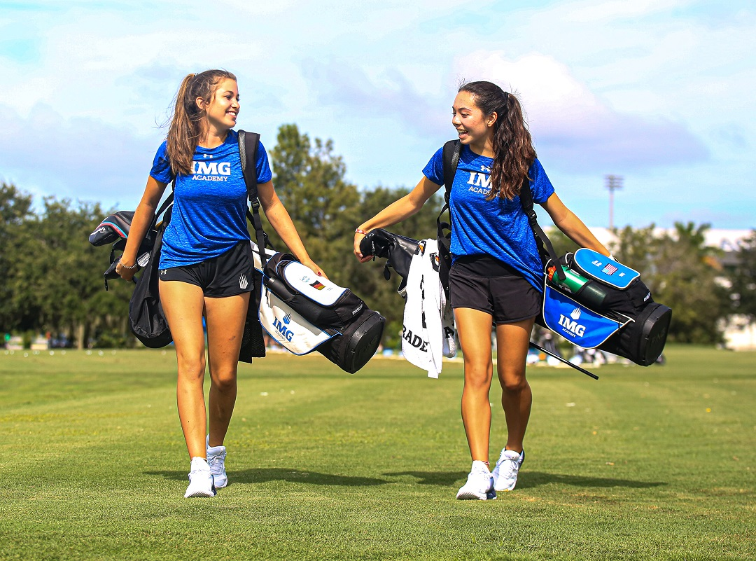 Two female IMG Academy golfers walk down a fairway | IMGAcademy.com