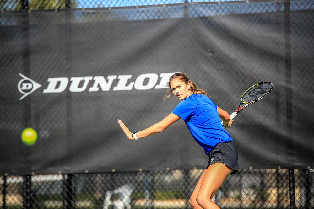 Female IMG Academy Tennis Athlete Prepares to Hit the Ball with a Forehand Swing