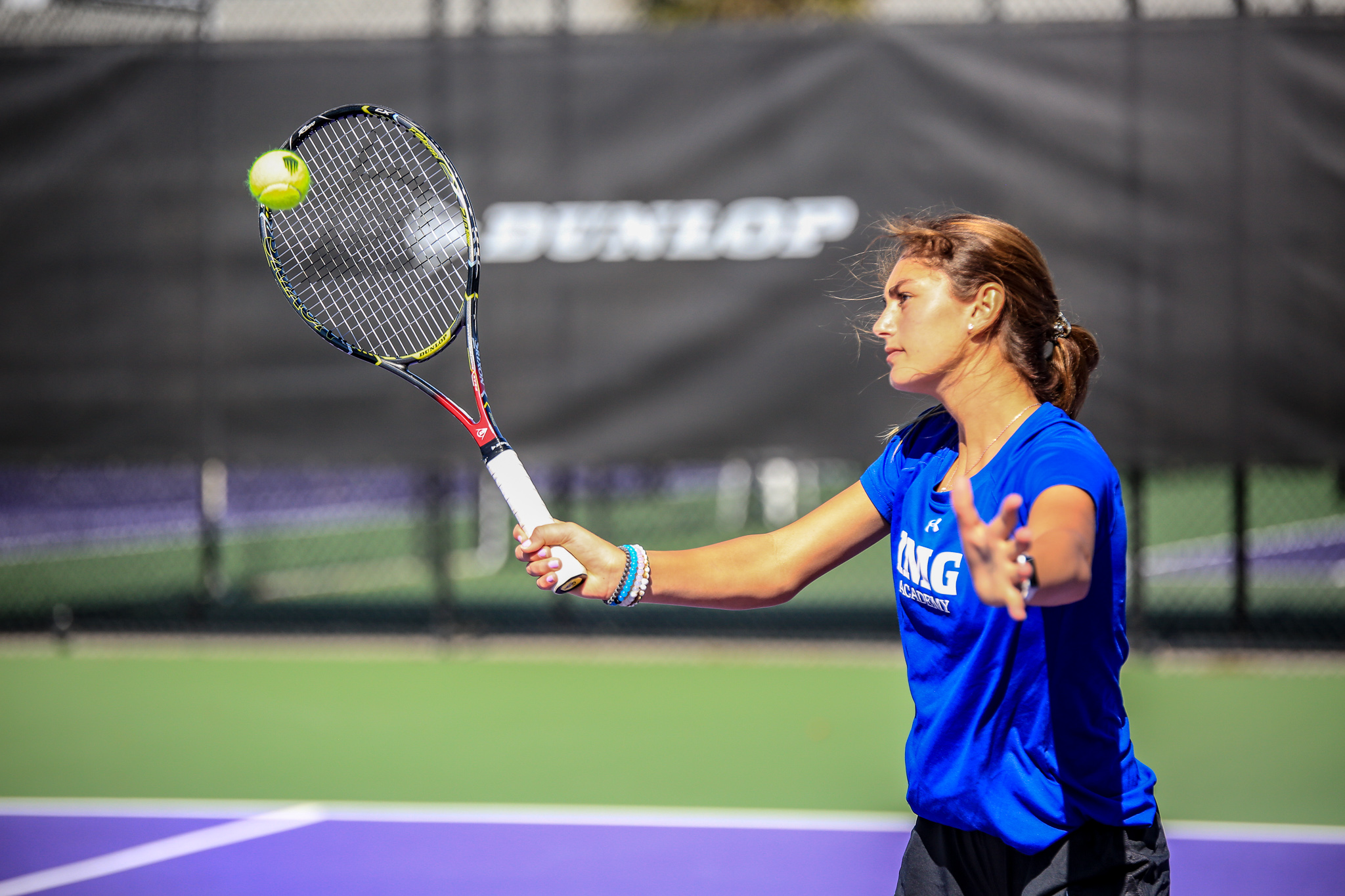 Girl hitting a tennis shot at IMG Academy | IMG Academy