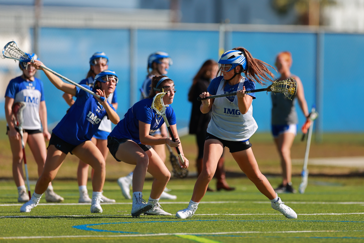 female lacrosse players practice at IMG Academy