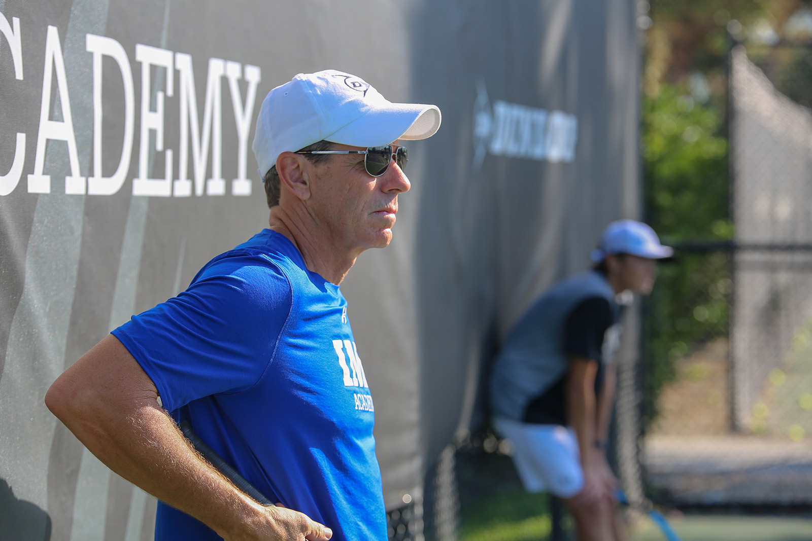 jimmy arias watches tennis practice from IMG Academy courts
